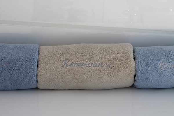 ren three towels rolled close up
